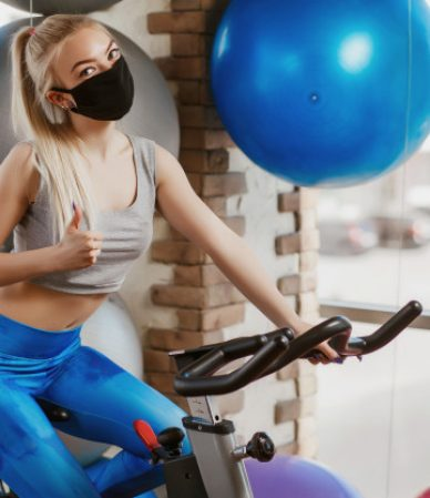 protective-masks-against-virus-infection-training-during-quarantine-gym-coronavirus-covid-19-protection-concept_98890-748